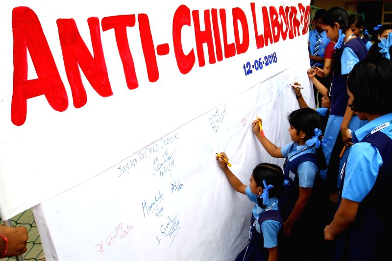 Children participate in an awareness and signature rally on World Day Against Child Labour, in Chennai on June 12, 2018.