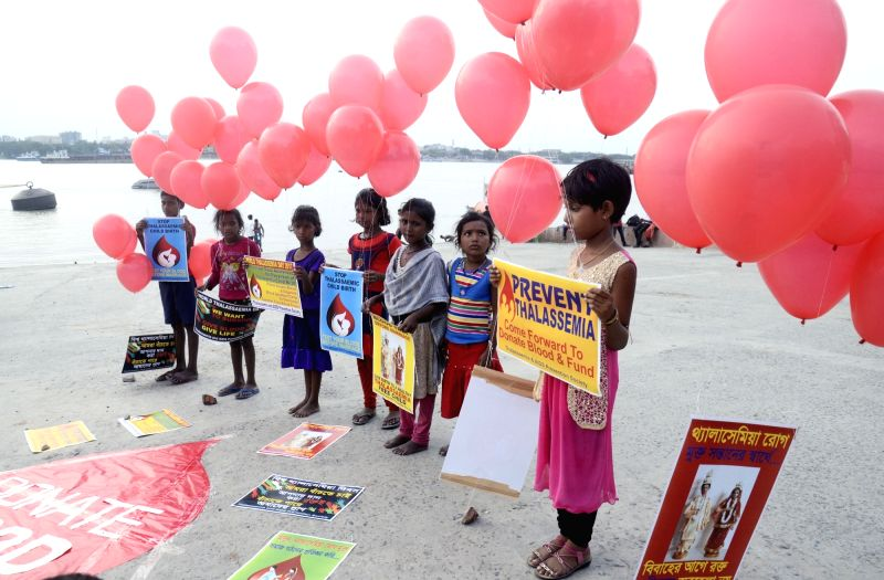 Children participate in an awareness programme organised on World Thalassemia Day  in Kolkata on May 8, 2017.
