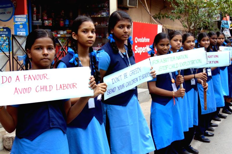 Children participate in an awareness rally on World Day Against Child Labour, in Chennai on June 12, 2018.