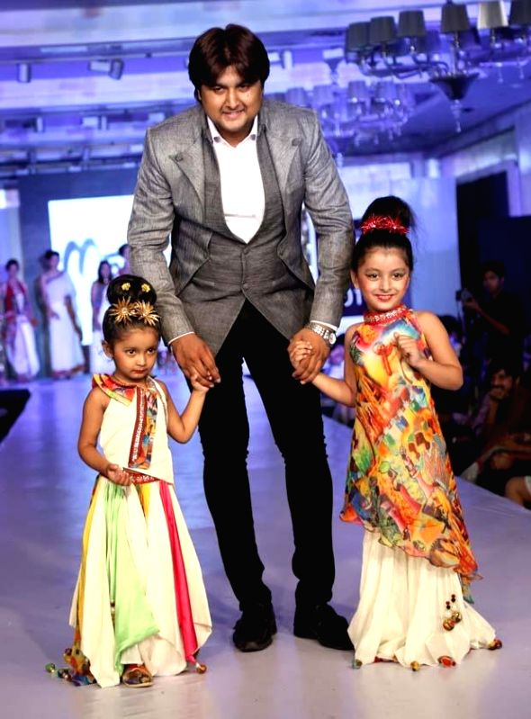 Children participate in `Fashion Fest 2014` in New Delhi.