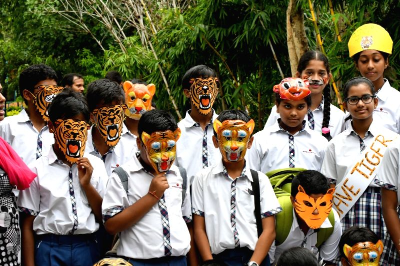 Children participate in Global Tiger Day celebrations at Nehru Zoological Park in Hyderabad on July 29, 2016.