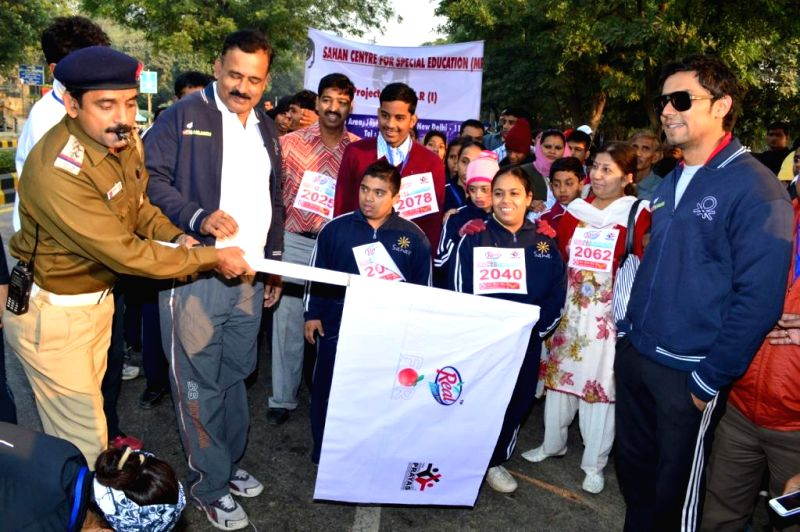 Children participate in Real Run for Children organised by Prayas on Children's day in New Delhi on Nov.14, 2013.
