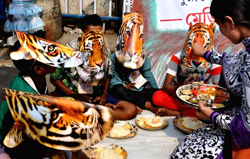 "Children participate in ""Save Tiger"" campaign during Bhai Duj in Kolkata, on Nov 13, 2015."