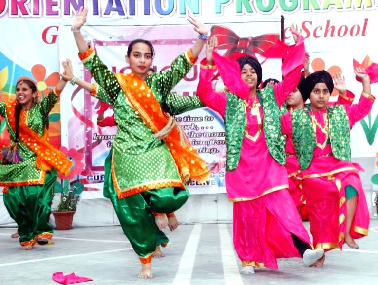 Children perform during a programme organised to celebrate Baisakhi at their school in New Delhi on April 13, 2014.