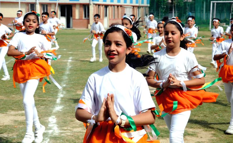 Children perform during an Independence Day programme in Gurgaon on Aug 15, 2014.