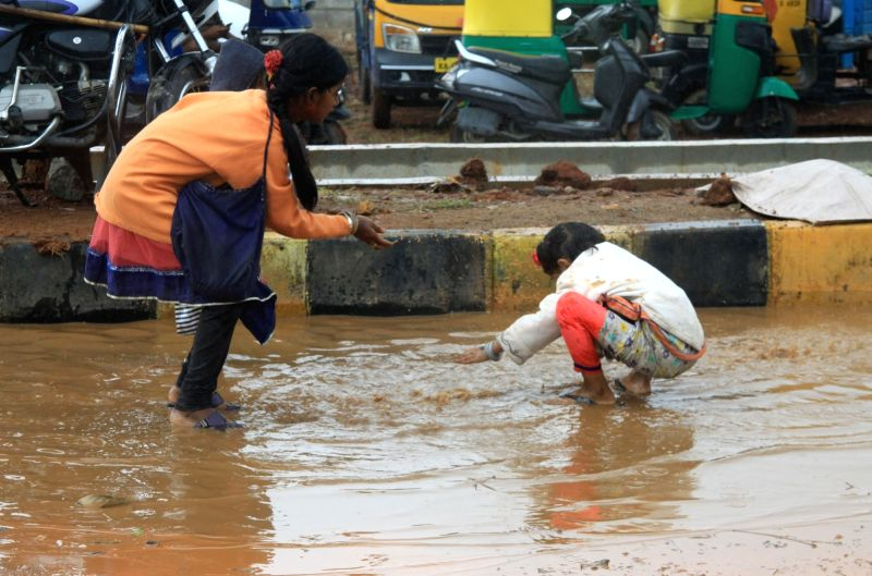 Children play as rains lash Bengaluru on Dec 1, 2017.