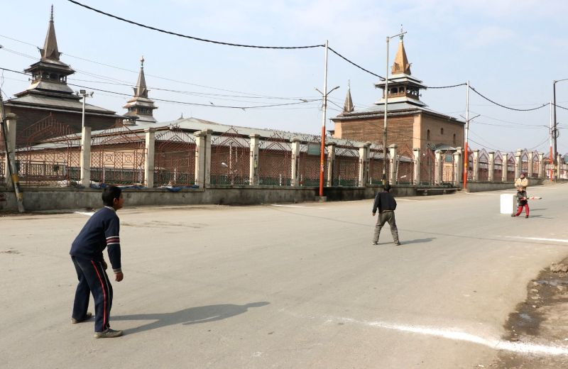 Children play cricket as authorities imposed restrictions in Srinagar and Shopian districts to prevent a separatist-called march in protest of the killing of five civilians over the last ...