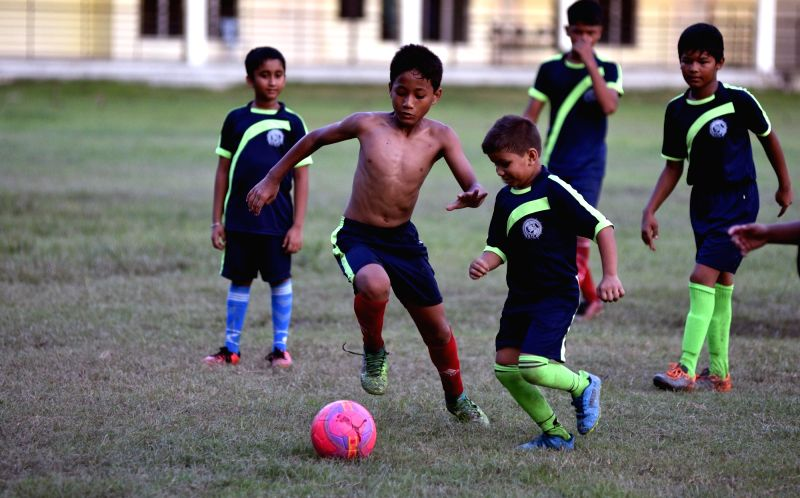 Children play football as FIFA fever grips the city during the ongoing FIFA World Cup 2018 being played in Russia; in Guwahati on July 15, 2018.
