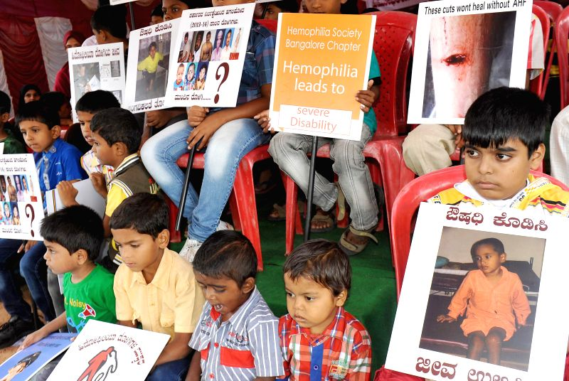 Children suffering from Hemophilia participate in a demonstration at Freedom Park in Bangalore on July 8, 2014.
