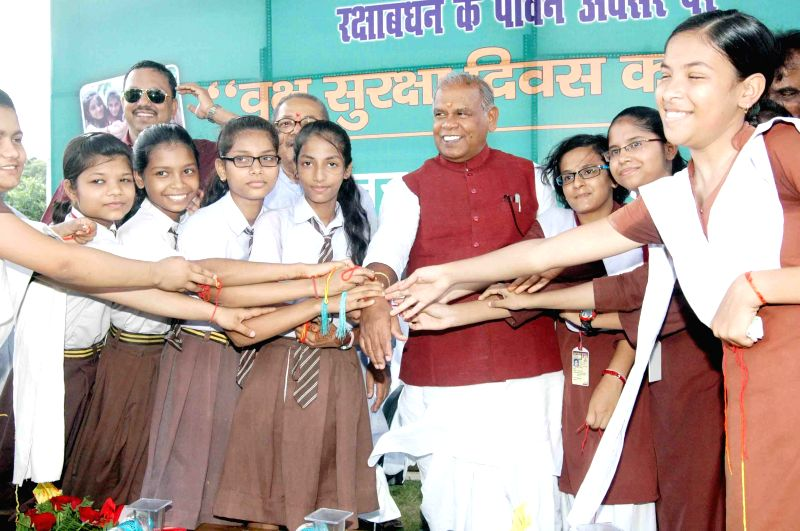 Children tie rakhis to Bihar Chief Minister Jitan Ram Majhi during a programme in Patna on Aug 10, 2014. (Photo: IANS) Thnx IANS - Jitan Ram Majhi