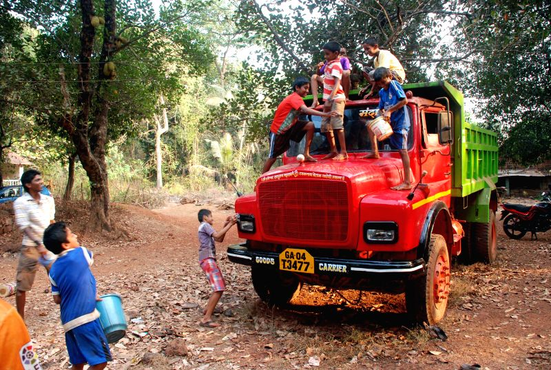 Children wash a truck used to carry minerals after the Supreme Court lifted a 19-month old ban on mining in Goa in Amona of Goa 30 km away from Panaji on April 21, 2014.