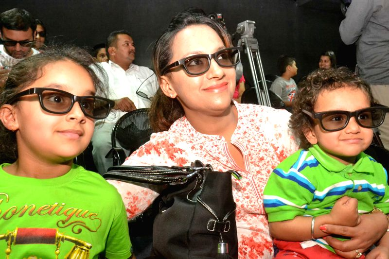 Children watch 'Dinosaur Alive' during the launch of the film at Visvesvaraya Industrial and Technological Museum in Bangalore on June 25, 2014.