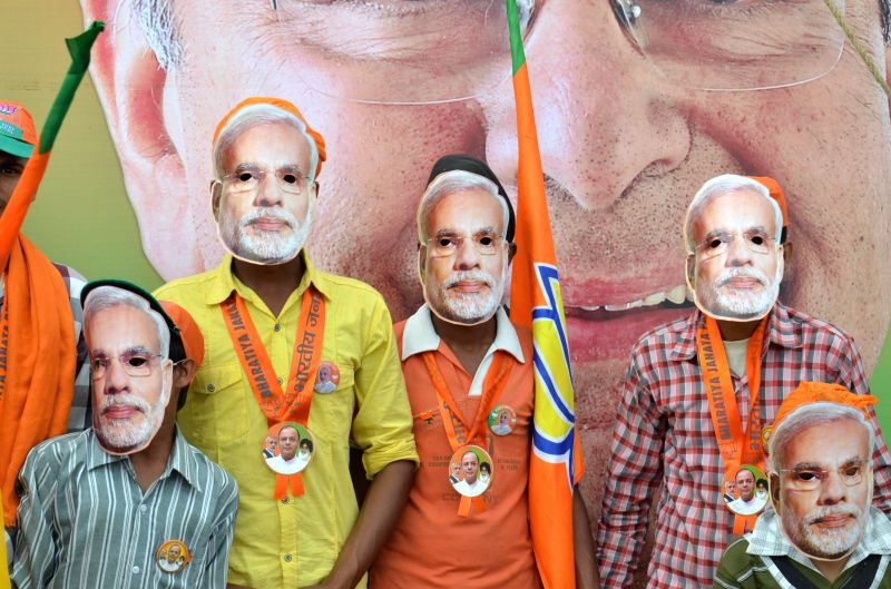 Children wear masks of BJP Prime Ministerial candidate and Gujarat Chief Minister Narendra Modi during an election rally of party's candidate for 2014 Lok Sabha Election from Amritsar, Arun Jaitley .. - Narendra Modi and Arun Jaitley