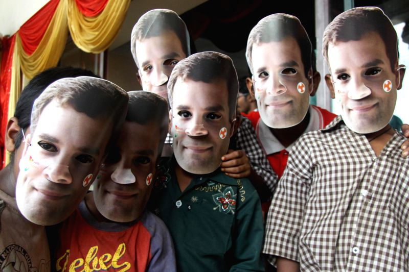 Children wear Rahul Gandhi`s masks during the 55th Youth Congress Foundation Day celebrations, at Patel Bhavan, in Bangalore on Aug. 9, 2014. - Rahul Gandhi
