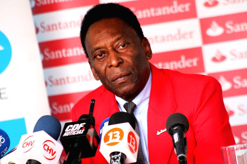 """The brazilian former soccer player, Pele, visits the neighborhood of La Pintana in Santiago de Chile, Chile, 9 April 2015. The purpose of his visit was to promote the campaign """"Solidarity ..."""