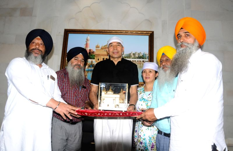 China's ambassador to India Luo Zhaohui receives a miniature of Golden Temple as a momento, in Amritsar, on Aug 10, 2018.