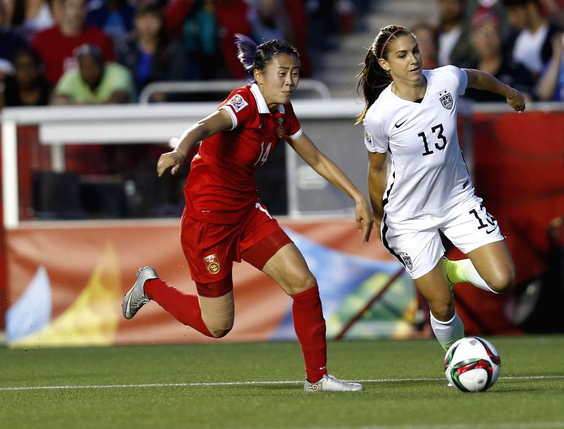 China's Zhao Rong (L) vies with Alex Morgan of the United States during the quarterfinal between China and the United States at Lansdowne Stadium in Ottawa, Canada ...