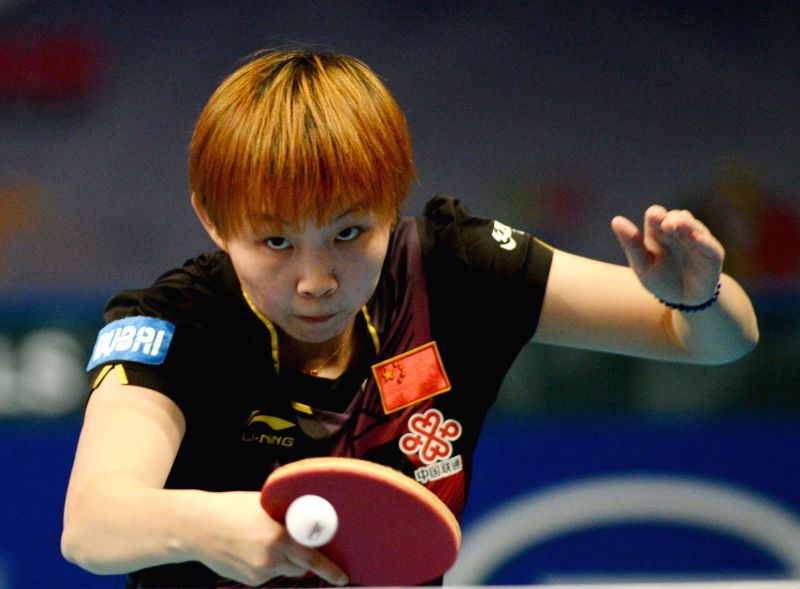 China's Zhu Yuling returns a shot against Singpore's Feng Tianwei during their women's singles match of the 2015 ITTF World Tour Grand Finals in Odivelas, outskirts ...