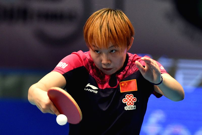 China's Zhu Yuling returns a shot against Japan's Ishikawa Kasumi during a women's single match of the 2015 ITTF World Tour Grand Finals in Odivelas, outskirts of ...