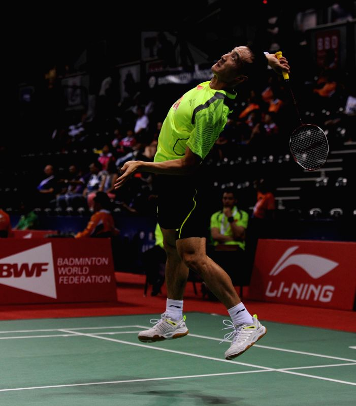 Chinese badminton player Du Pengyu in action  during a Thomas Cup and Uber Cup match at Siri Fort Stadium in New Delhi on May 18, 2014.