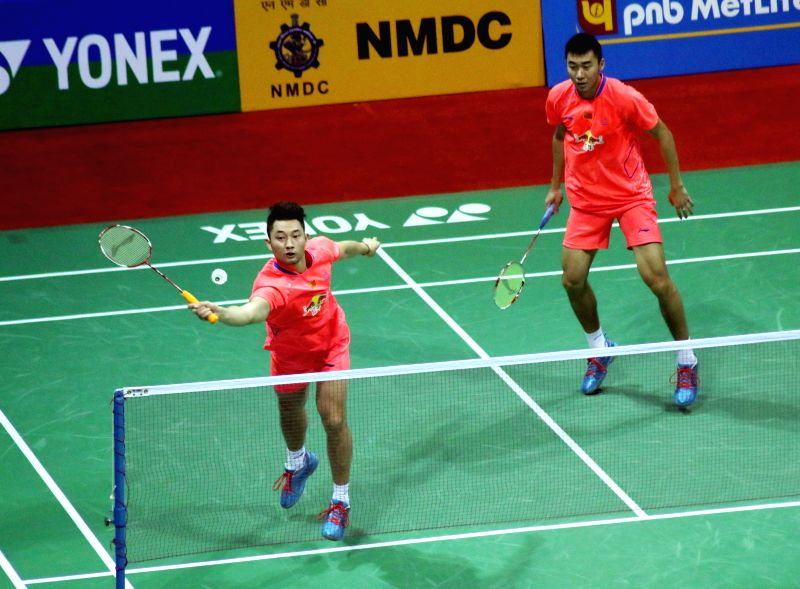 Chinese badminton players Chai Biao and Hong Wei in action against their Danish counterparts Mads Pieler Kolding and Mads Conrad-Petersen during a match of Yonex Sunrise Indian Open Badminton ...