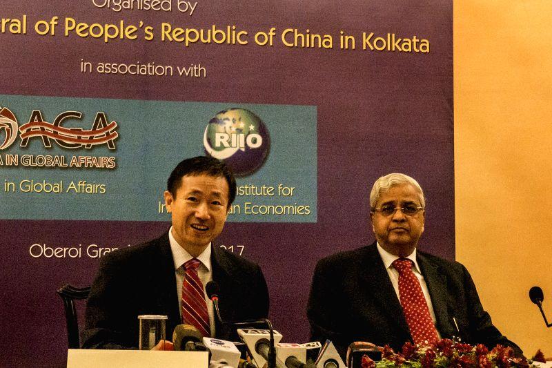 Chinese Consul General in Kolkata Ma Zhanwu and Belarus Consulate Sitaram Sharma during a press conference in Kolkata on Aug 4, 2017. - Consulate Sitaram Sharma