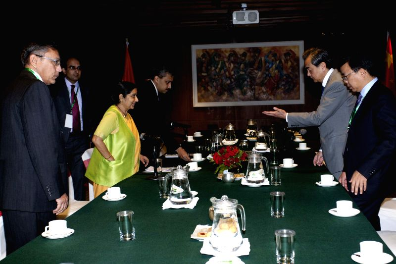 Chinese Foreign Minister Wang Yi (2nd R) meets with Indian Foreign Minister Sushma Swaraj (3rd L) in Kathmandu, Nepal, June 25, 2015. Both ministers came to ... - Wang Y and Sushma Swaraj