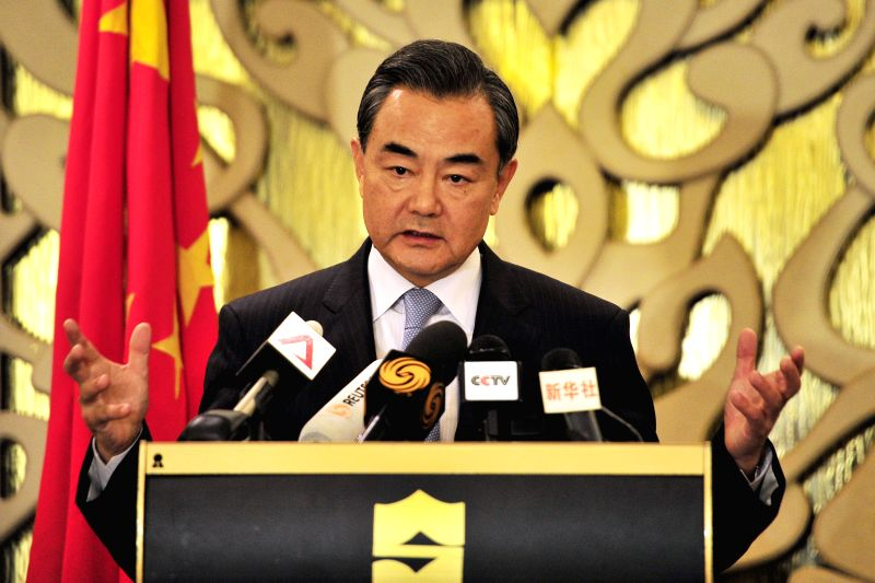 Chinese Foreign Minister Wang Yi addresses a news conference in Singapore, Aug. 3, 2015. Wang visited Singapore from August 2 to 3. (Xinhua/Then Chih Wey) - Wang Y