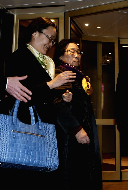 Chinese herbal expert and Nobel Prize Laureate Tu Youyou (R) arrives for 2015 Nobel Prize awards ceremony in Stockholm, capital of Sweden, Dec. 4, 2015. Tu was ...