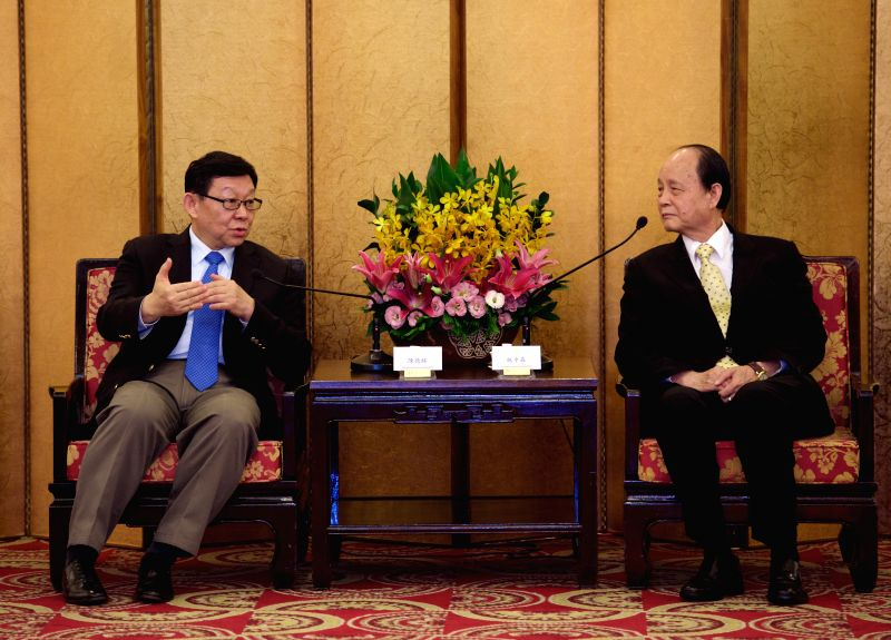 Chinese mainland-based Association for Relations Across the Taiwan Straits (ARATS) President Chen Deming (L) meets with Taiwan-based Straits Exchange Foundation ...