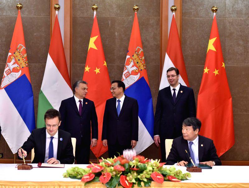 Chinese Premier Li Keqiang (C rear), Hungarian Prime Minister Viktor Orban (L rear), and Serbian Prime Minister Aleksandar Vucic (R rear) attend a signing ceremony ... - Viktor Orban