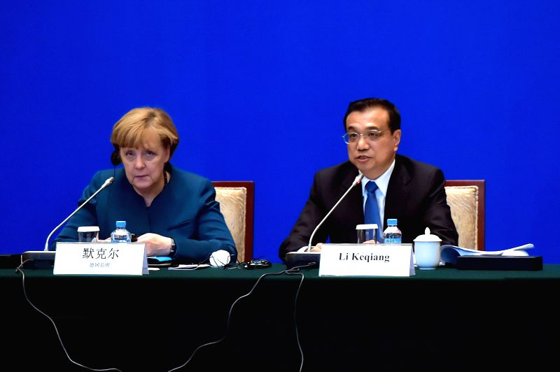 Chinese Premier Li Keqiang (R) and German Chancellor Angela Merkel attend a seminar of Sino-German Advisory Committee on Economy with business leaders from both ...