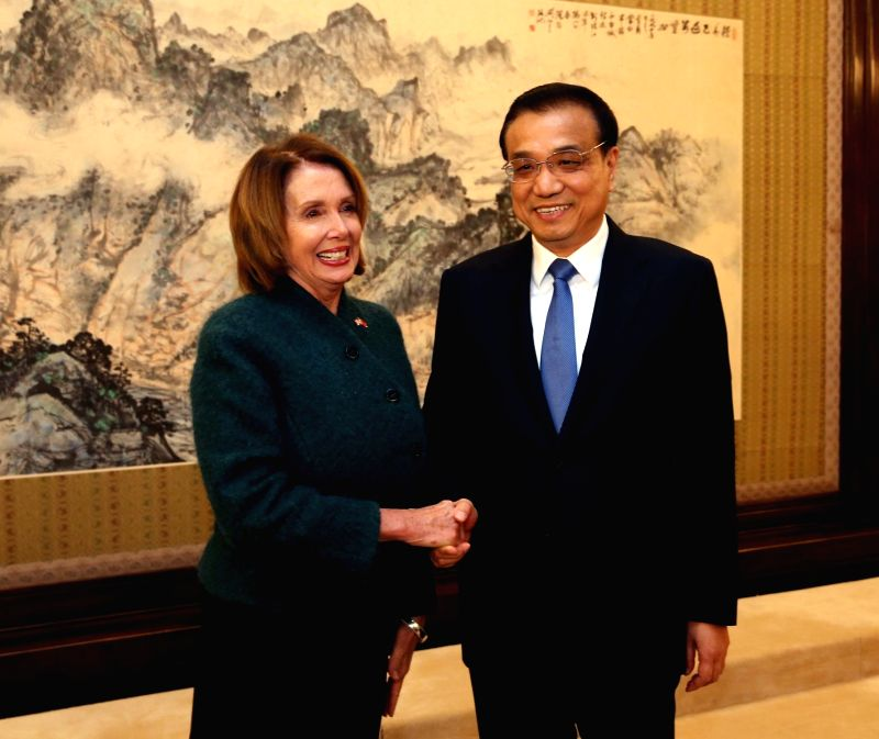 Chinese Premier Li Keqiang (R) meets with the U.S. House of Representatives Minority Leader Nancy Pelosi, who has led a U.S. congressional delegation to China, in ...