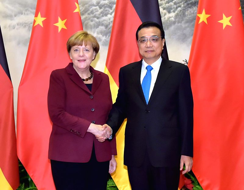 Chinese Premier Li Keqiang (R) shakes hands with German Chancellor Angela Merkel at the Great Hall of the People in Beijing, China, Oct. 29, 2015. (Xinhua/Li ...