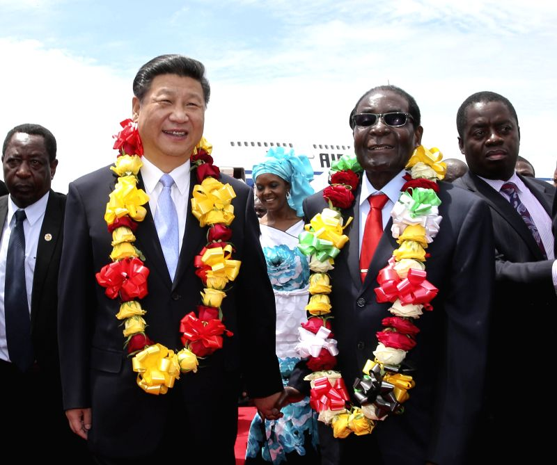 Chinese President Xi Jinping (L, front) is welcomed by Zimbabwean President Robert Mugabe in Harare, Zimbabwe, Dec. 1, 2015. Xi arrived here Tuesday for a state visit ...