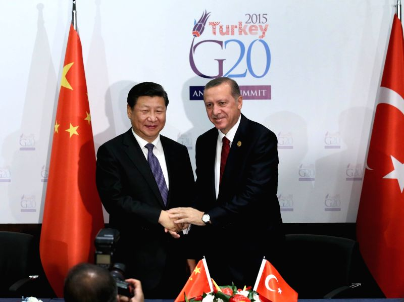 Chinese President Xi Jinping (L) shakes hands with his Turkish counterpart Recep Tayyip Erdogan in Antalya, Turkey, Nov. 14, 2015.