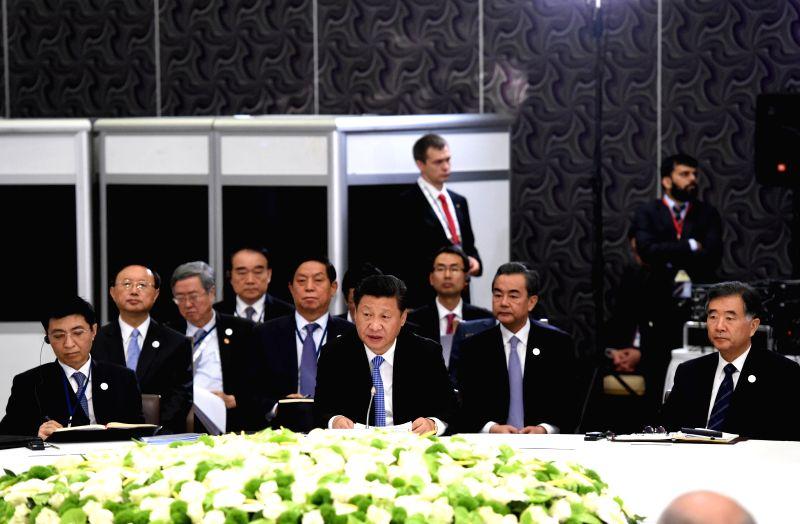 Chinese President Xi Jinping speaks at a BRICS leaders' meeting held in Antalya, Turkey, Nov. 15, 2015.