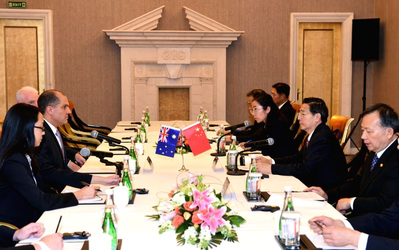 Chinese State Councilor and Minister of Public Security Guo Shengkun (2nd R) meets with Deputy Commissioner of Australian Federal Police Ramzi Jabbour (2nd L) who ...