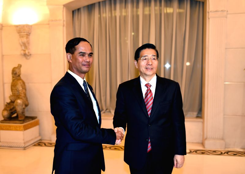 Chinese State Councilor and Minister of Public Security Guo Shengkun (R) meets with Deputy Minister for Home Affairs of Myanmar Aung Soe who is attending the ...