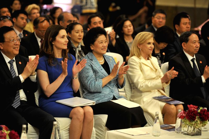Chinese Vice Premier Liu Yandong (3rd L) claps hands during the opening concert of the China-U.S. Composers Project in Washington, the United States, on June 22, ...