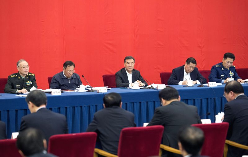 Chinese Vice Premier Wang Yang (C, rear) speaks at the symposium on development of old revolutionary areas in Beijing, capital of China, Nov. 27, 2015. (Xinhua/Wang ...