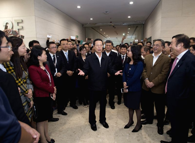Chinese Vice Premier Zhang Gaoli (C front) visits Huawei company in Shenzhen, south China's Guangdong Province, Nov. 30, 2015. Zhang made an inspection tour in ...