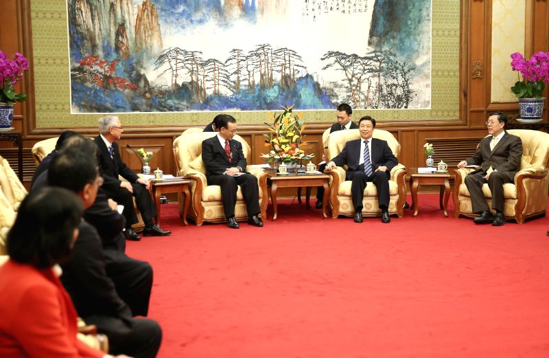 Chinese Vice President Li Yuanchao (2nd R, front) meets with a Japanese delegation led by Secretary General of the Liberal Democratic Party Tanigaki Sadakazu and ...