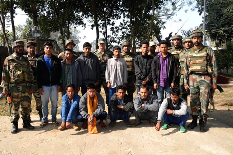 Security personnel present 11 NDFB (S) militants who were apprehended by the forces with a huge cache of arms and ammunition in Chirang district of Assam on Jan 19, 2015.