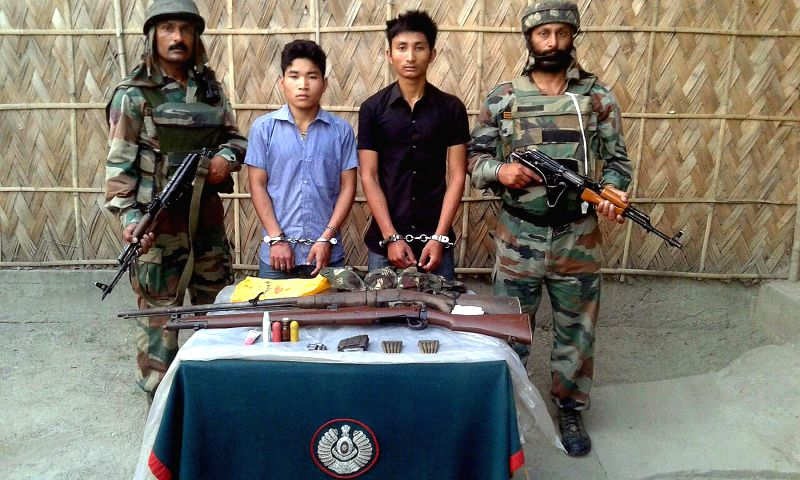 Two alleged NDFB(S) militants, who were apprehended in a joint operation of Army and Assam police from Barshijhar area in Chirang district of Assam, being presented before press on March 11, ...