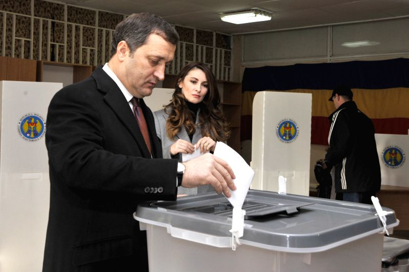 Chisinau (Moldova): Moldovan Liberal Democratic Party leader Vlad Filat casts his vote a voting booth during a parliamentary election at a polling station in Chisinau Nov. 30, 2014. Parliamentary ...