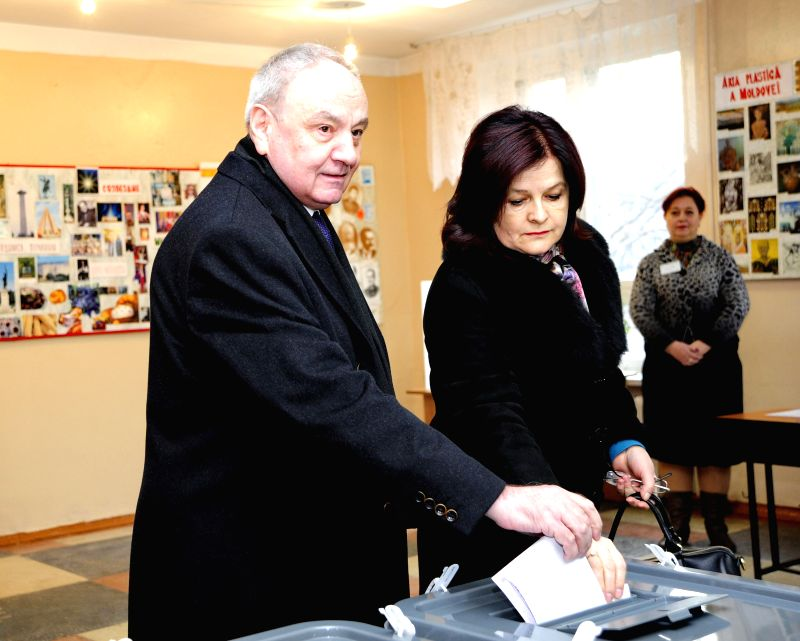 Chisinau (Moldova): Moldovan President Nicolae Timofti(L) casts his vote a voting booth during a parliamentary election at a polling station in Chisinau Nov. 30, 2014. Parliamentary elections kick ...