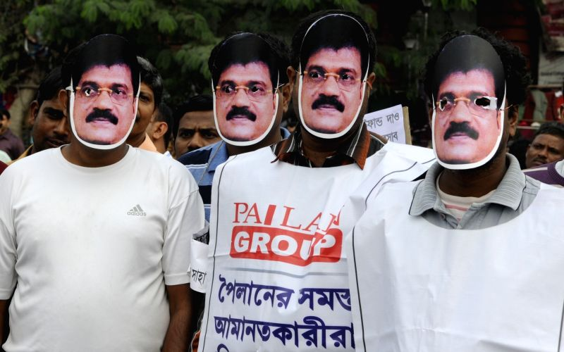 Chit fund agents and sufferers take part in a protest rally against West Bengal government in Kolkata on Dec 11, 2015.