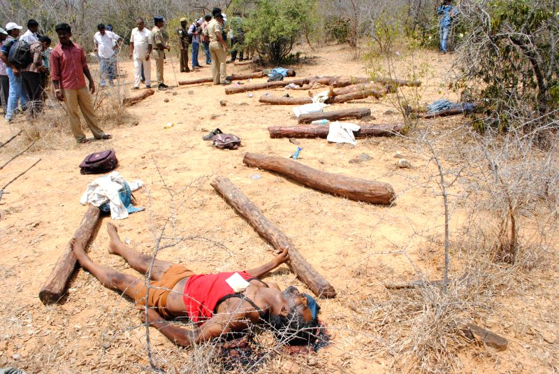 The bodies of the smugglers of red sanders -an expensive wood used in aphrodisiac drugs and to make musical instruments - who were gunned down by police in AndhraPradesh's Chittoor district ...