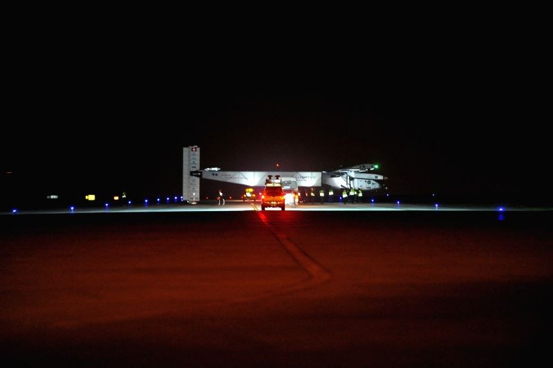 Solar Impulse 2 prepares to take off from Jiangbei International Airport in Chongqing Municipality, southwest China, April 21, 2015. Solar Impulse 2, the world's ...